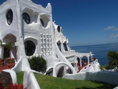 Casapueblo, a livable sculpture by Carlos Páez Vilaró, resembles a whipped-cream pie.